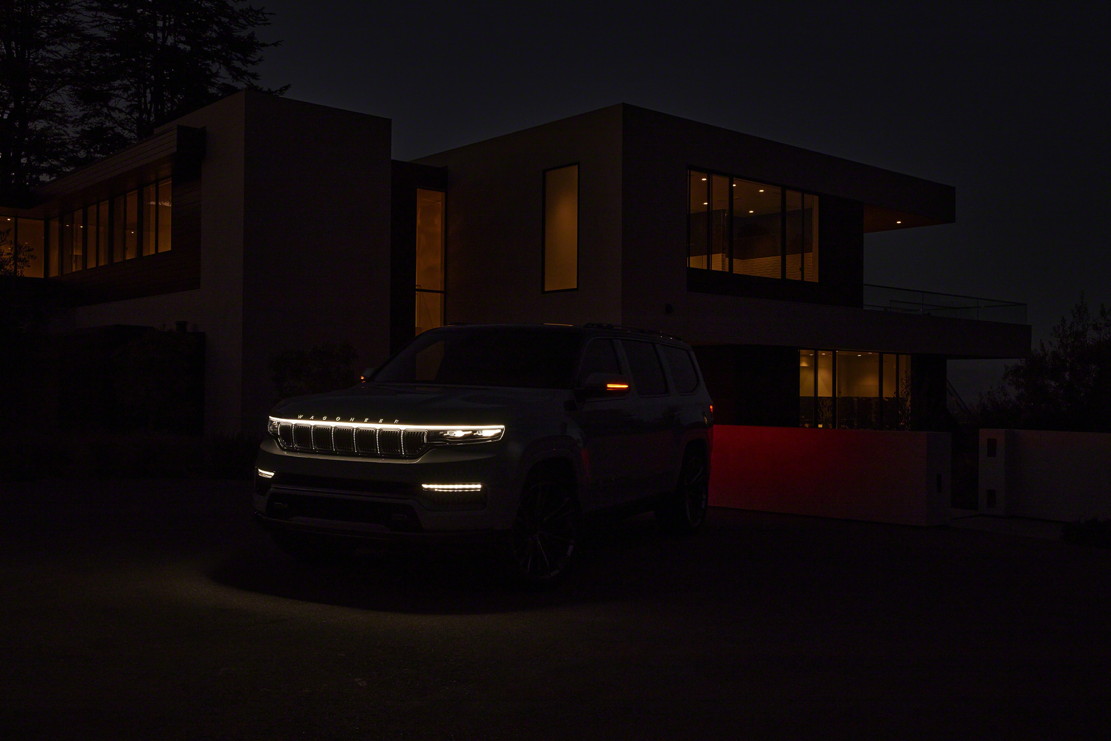 Grand Wagoneer Concept front lighting elements in dark in front of house