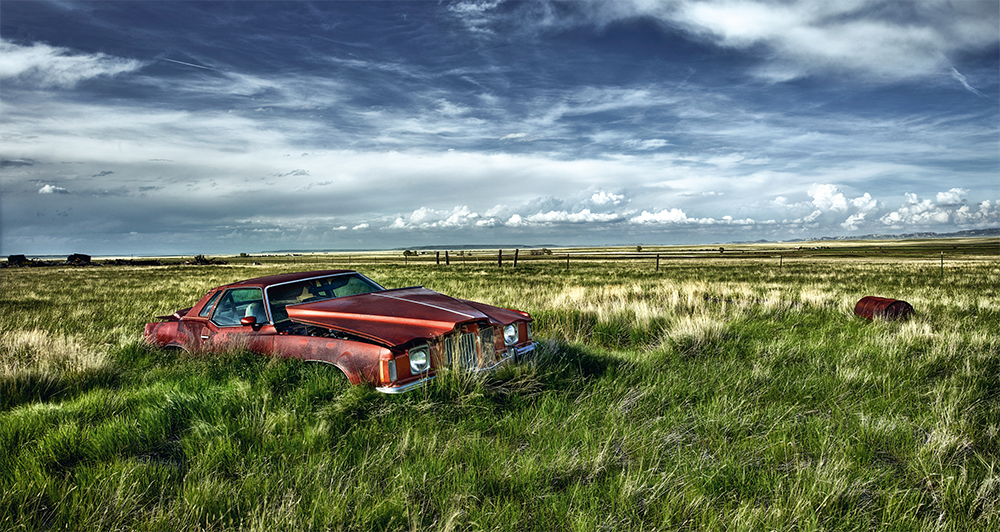 1974 Pontiac Grand Prix in grassy field plains wyoming usa