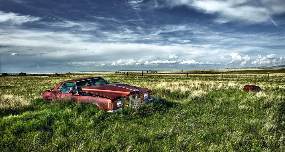 1974 Pontiac Grand Prix in grassy field plains wyoming usa