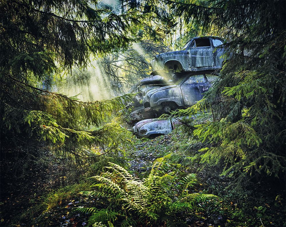 saab austin stack pile cars in mossy swedish forest