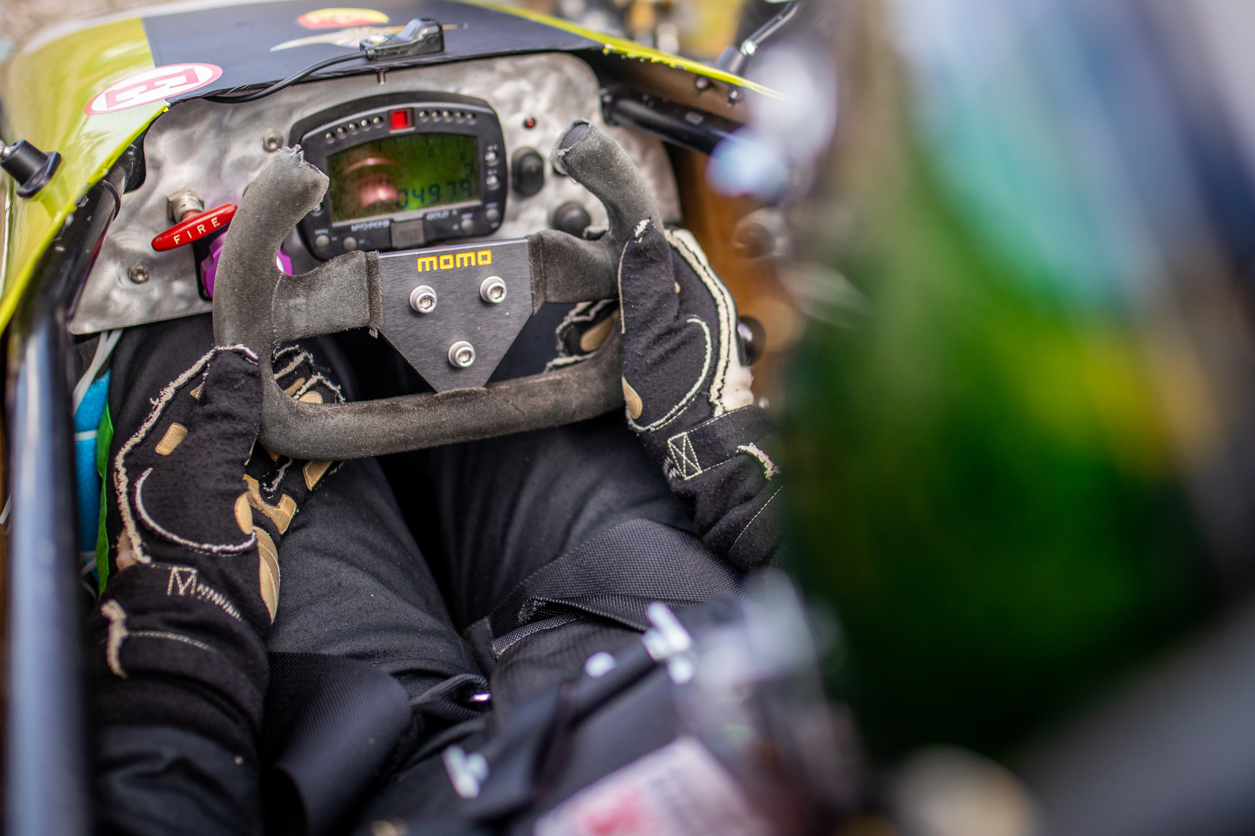 Formula First racecar driver jack baruth behind wheel