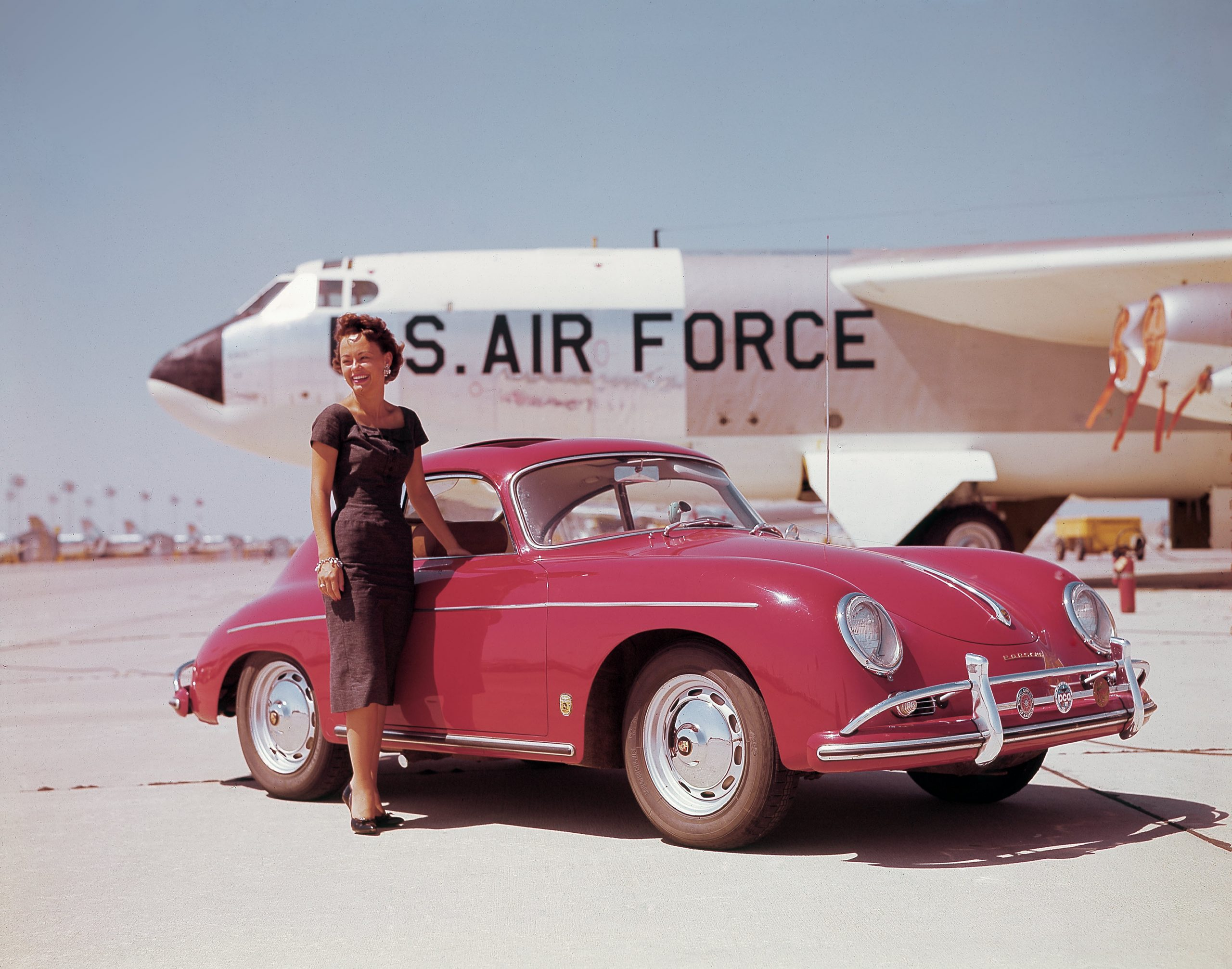 1957 red porsche 356 a coupe on air force tarmac