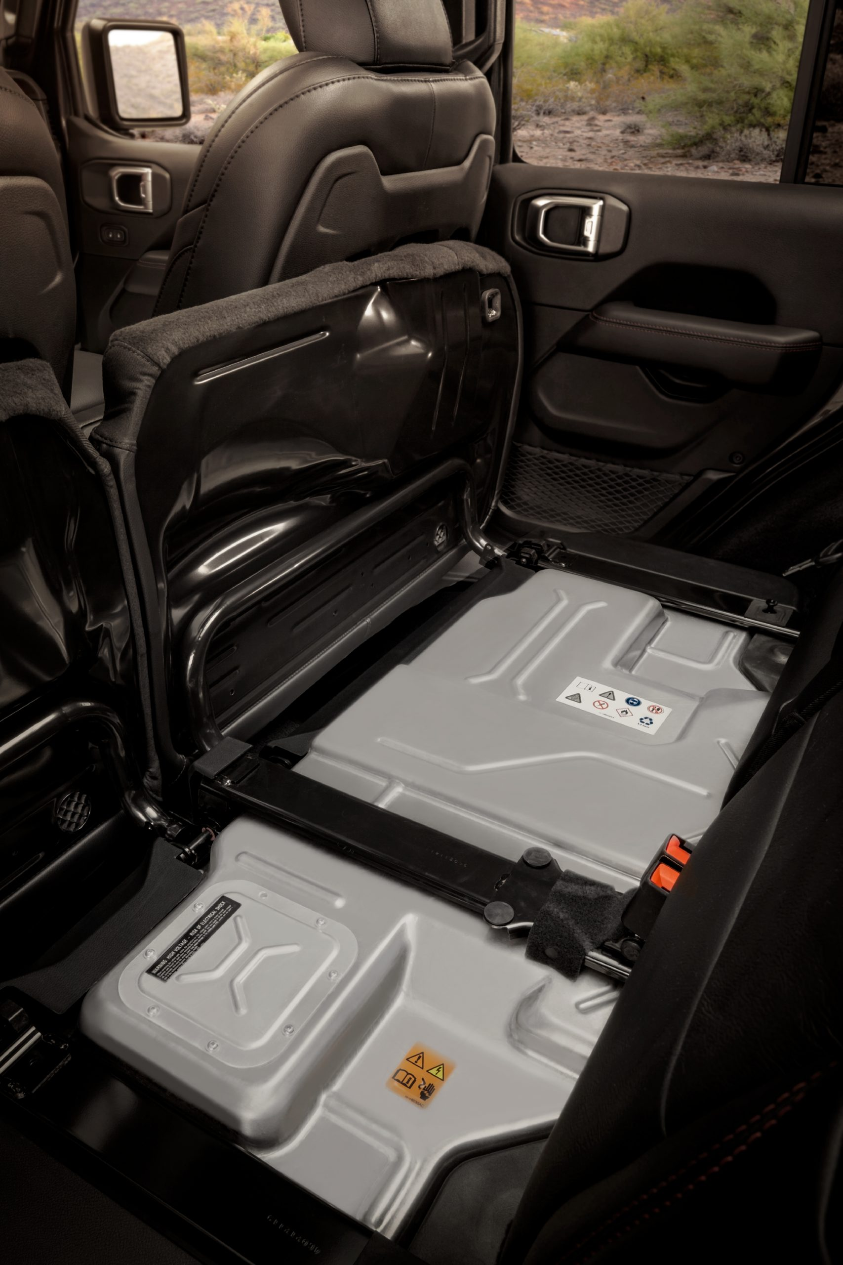 The Jeep® Wrangler 4xe's 400-volt, 17kWh battery pack mounts beneath the second-row seat, where it is protected from outside elements.