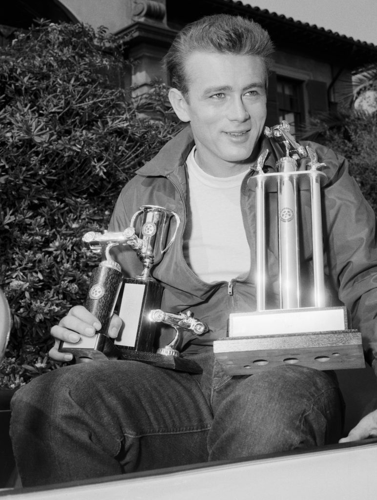James Dean Holding Trophies for Racing