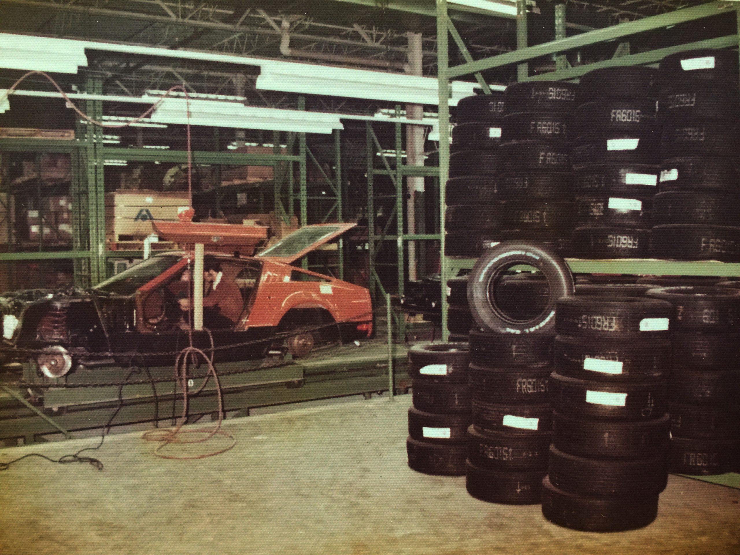 bricklin sv-1 assembly line beside tires