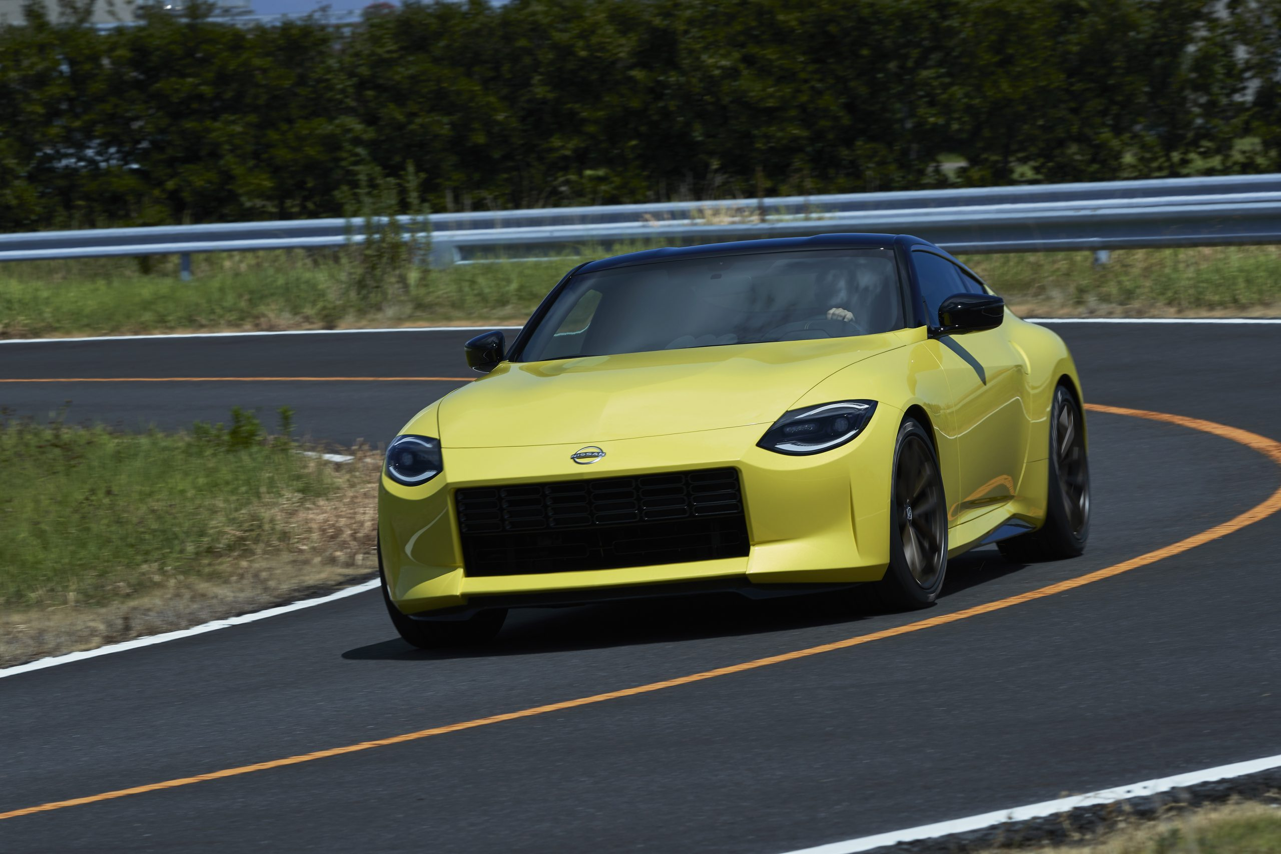 nissan new z car prototype front three-quarter cornering dynamic action