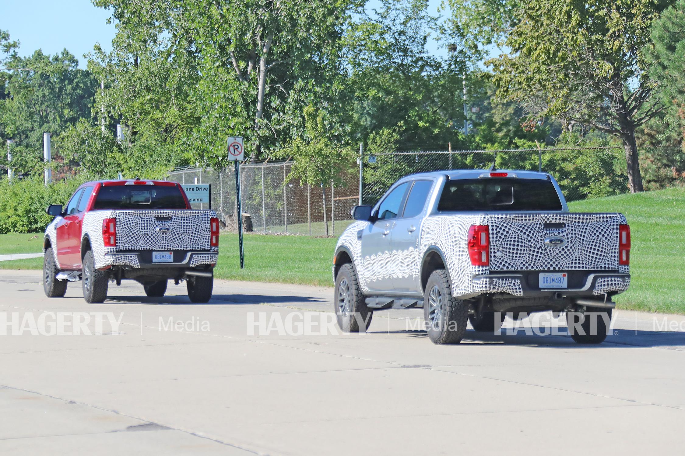 ford ranger tremor spy photo two trucks rear three-quarter