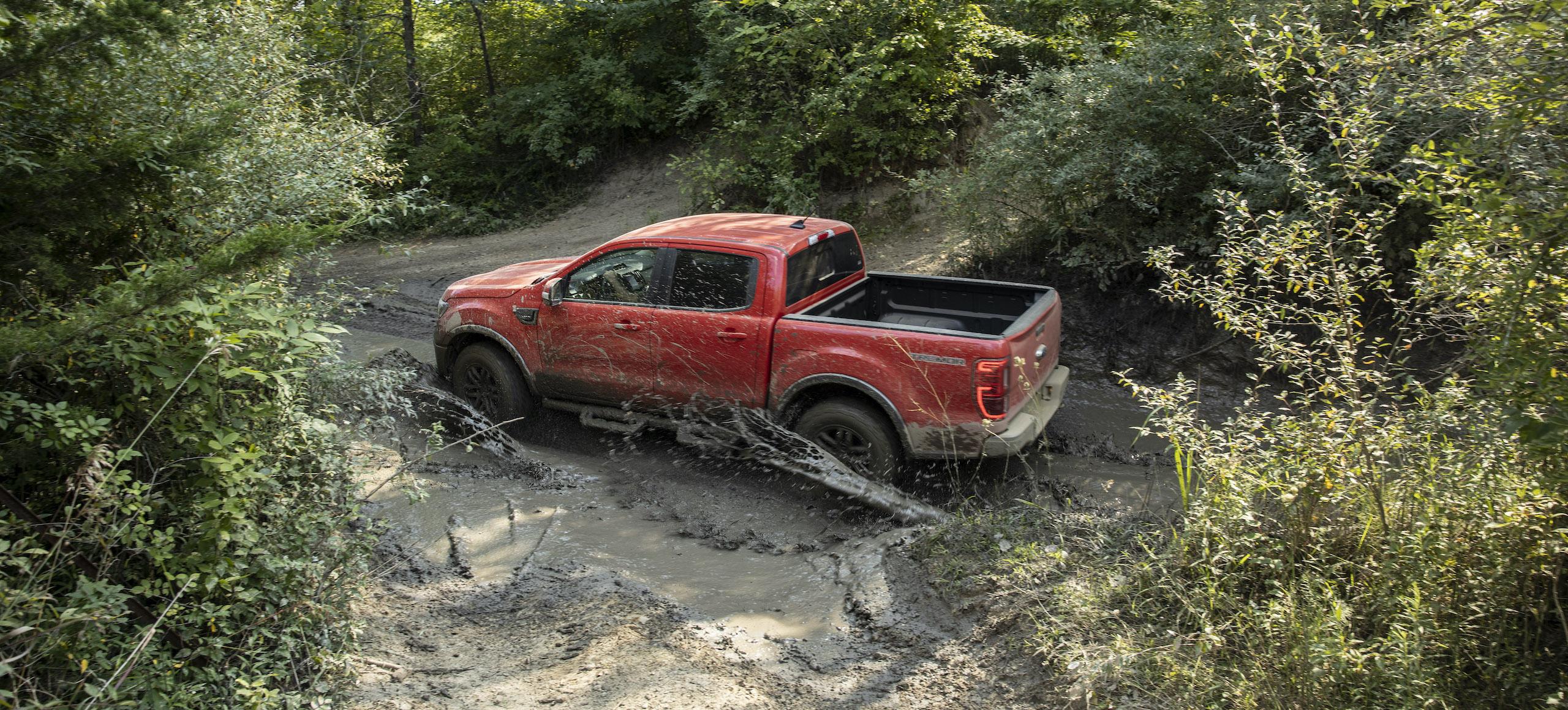 Ranger Tremor Lariat rear three-quarter off road mud action