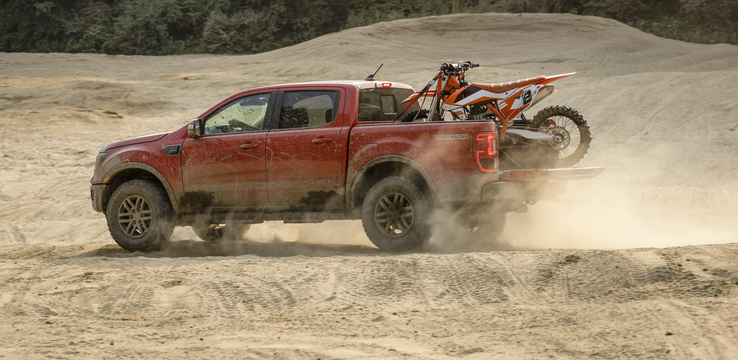 Ranger Tremor Lariat rear three-quarter off road dune action motorbike loaded in bed