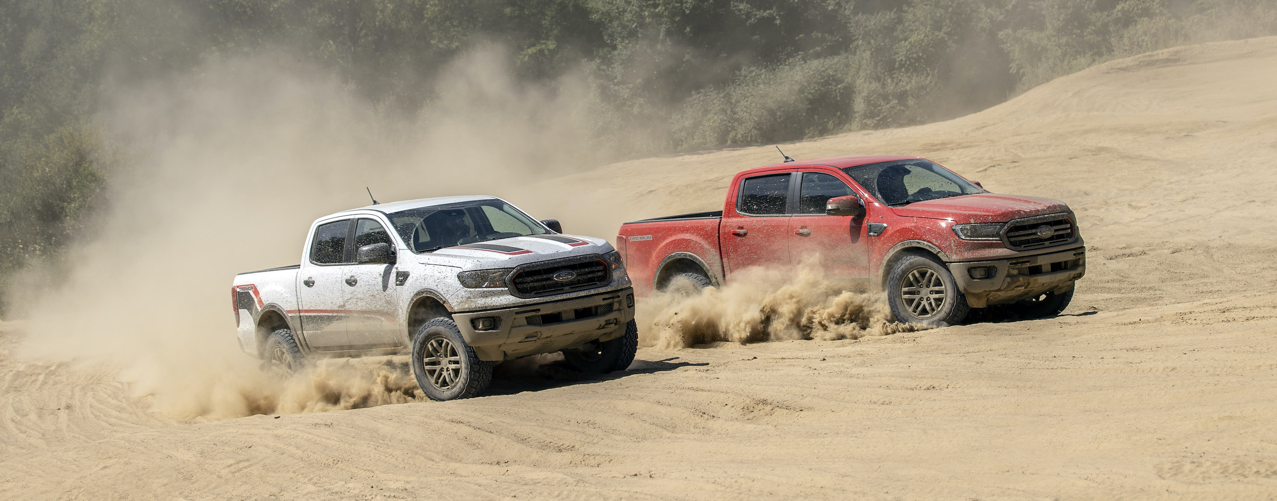Ranger Tremor XLT and lariat front three-quarter off road dune sand action