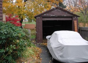 old garage and 911SC under car cover