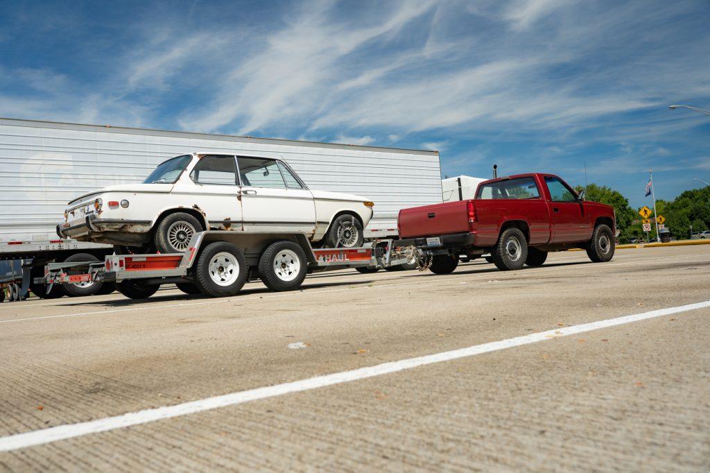 loaded bmw 2002 project car behind chevrolet silverado cheyenne