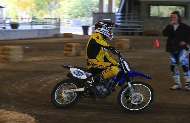 American Supercamp Riding School moto rider on dirt action