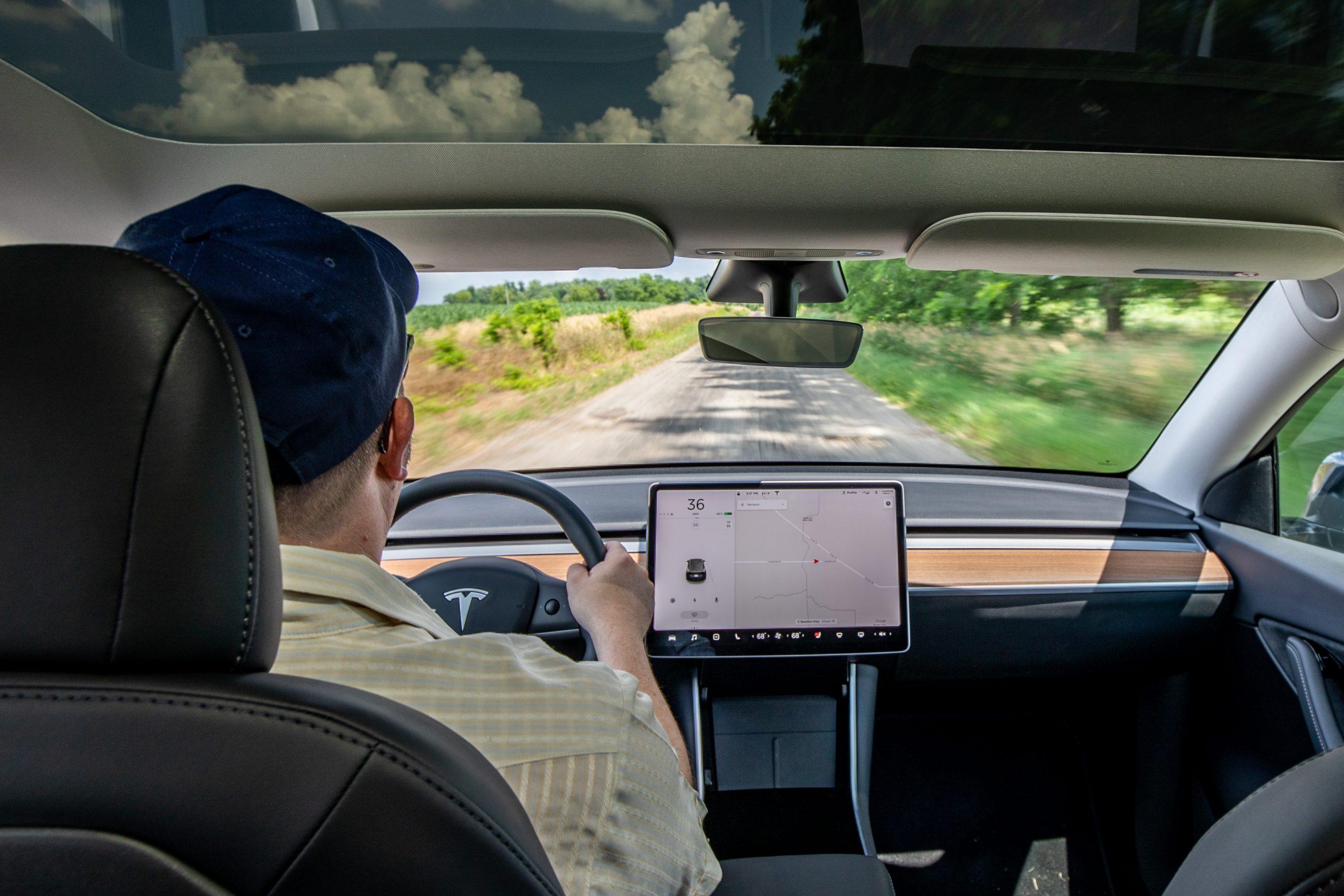Tesla Model Y interior front driver behind wheel