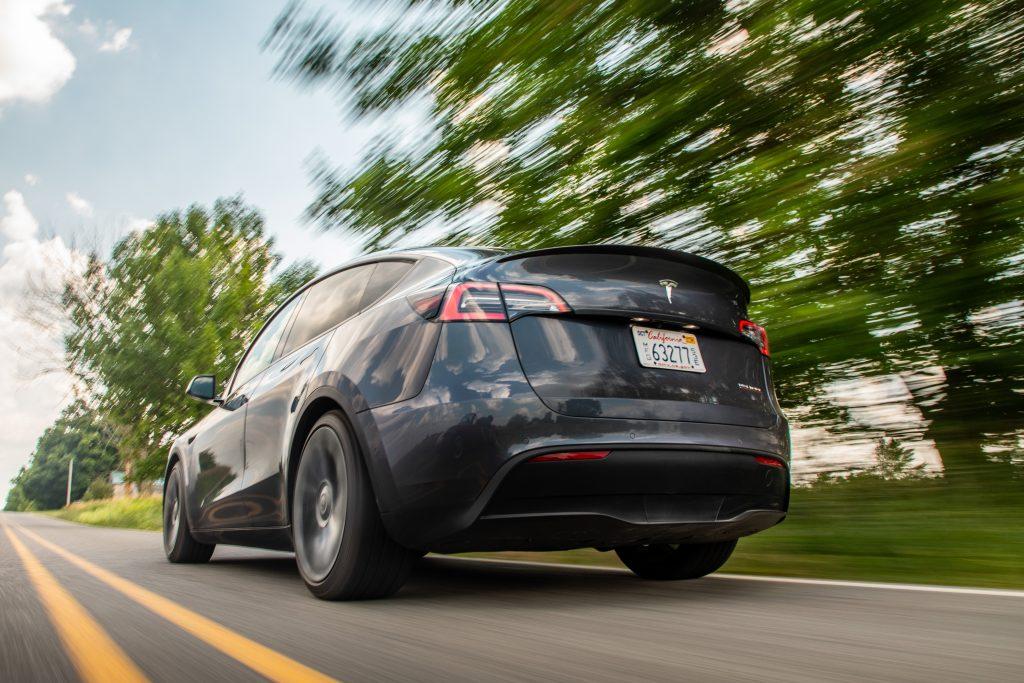 Tesla Model Y rear three-quarter dynamic road action