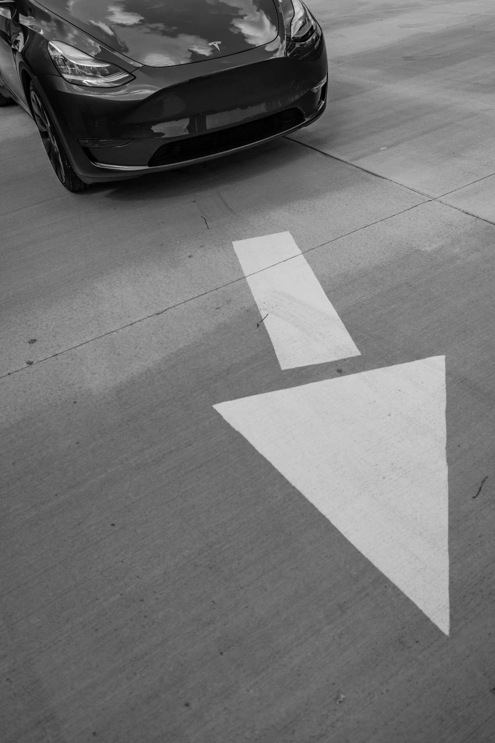 Tesla Model Y pavement arrow front action
