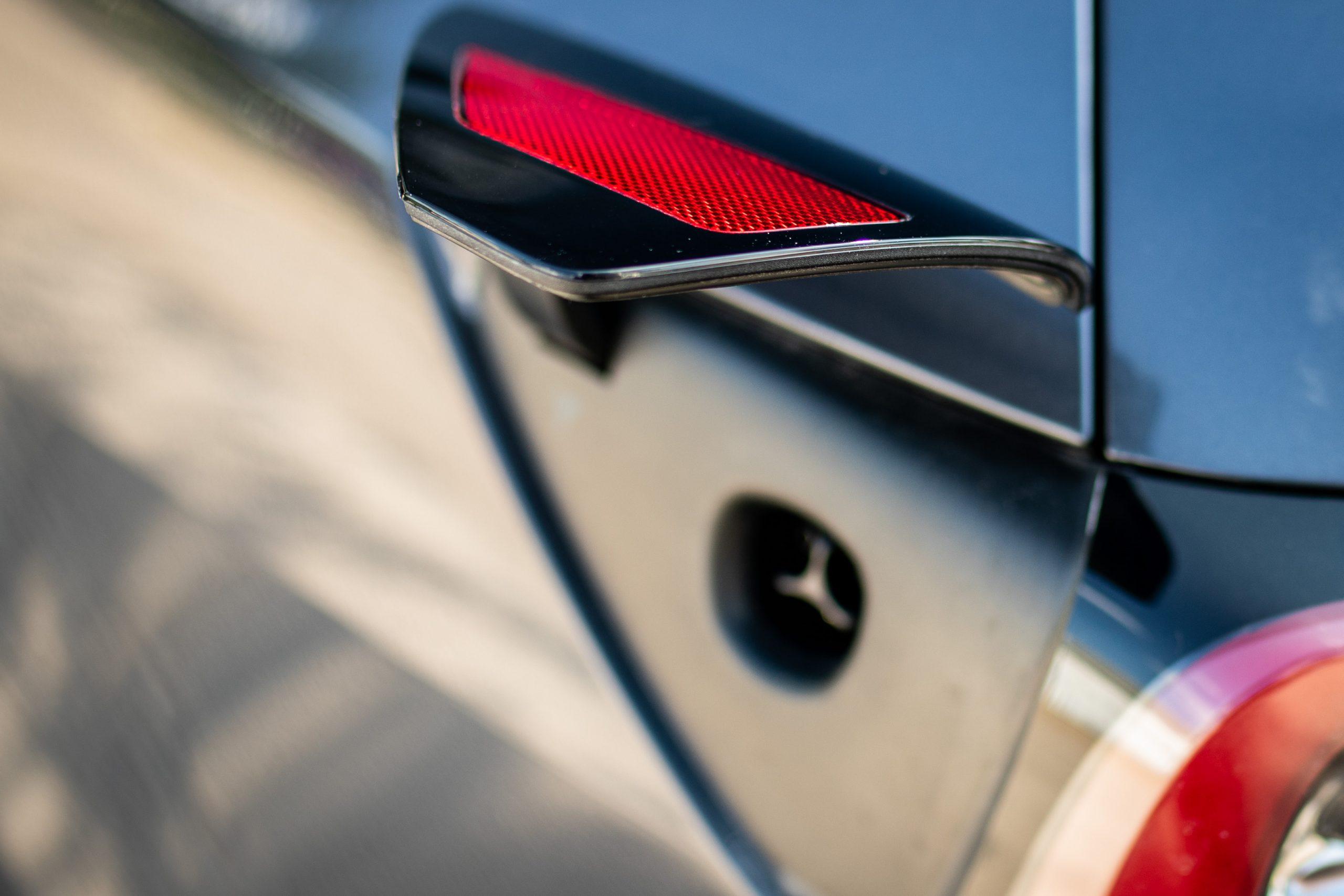 Tesla Model Y charging port door detail