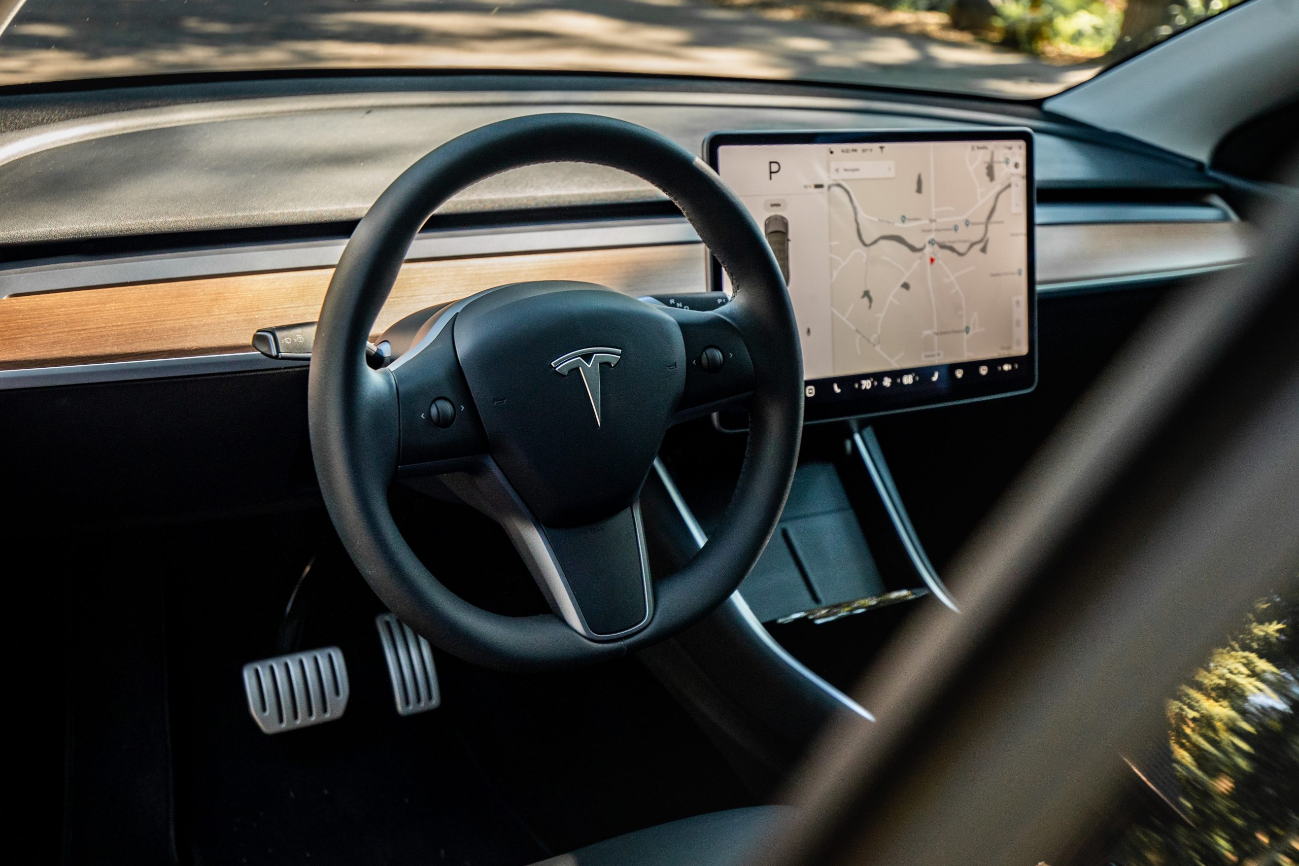 Tesla Model Y interior wheel and infotainment screen detail