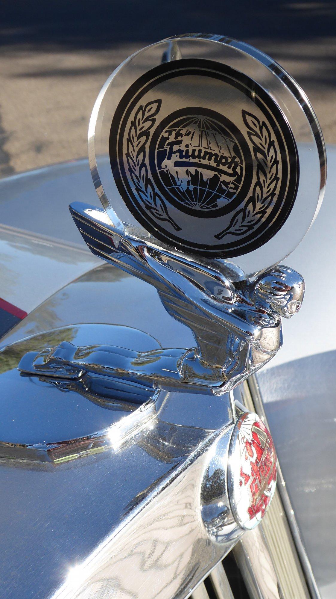 restored triumph roadster hood ornament