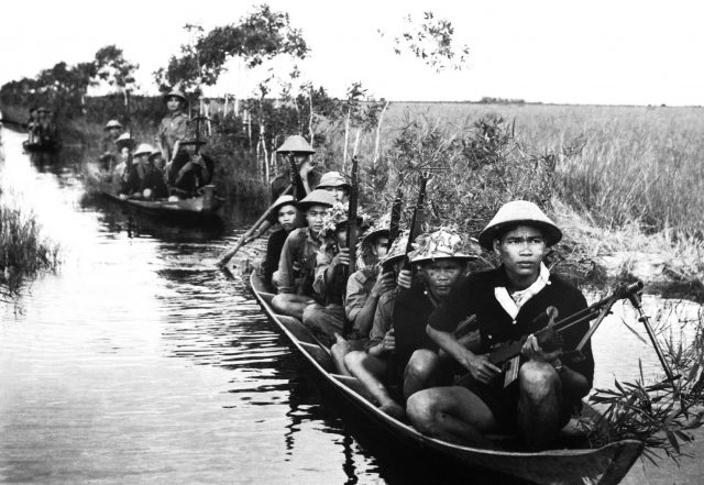 armed viet cong fighters in boats