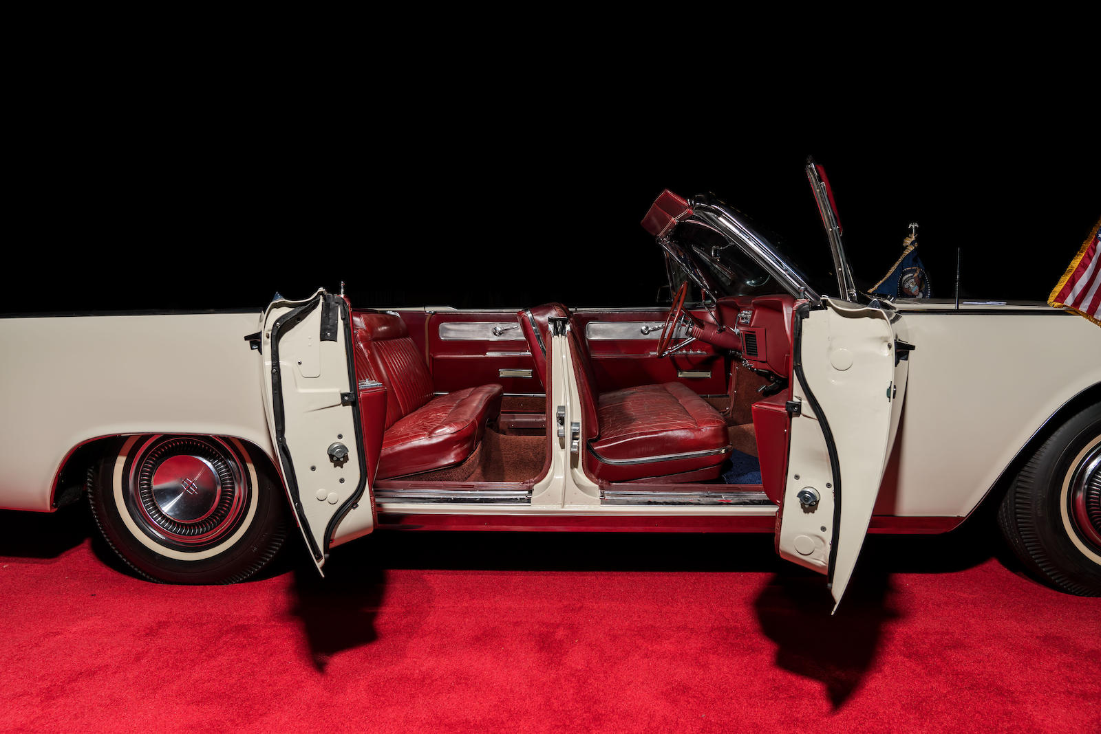 White 1963 Lincoln Limo One continental side profile open doors