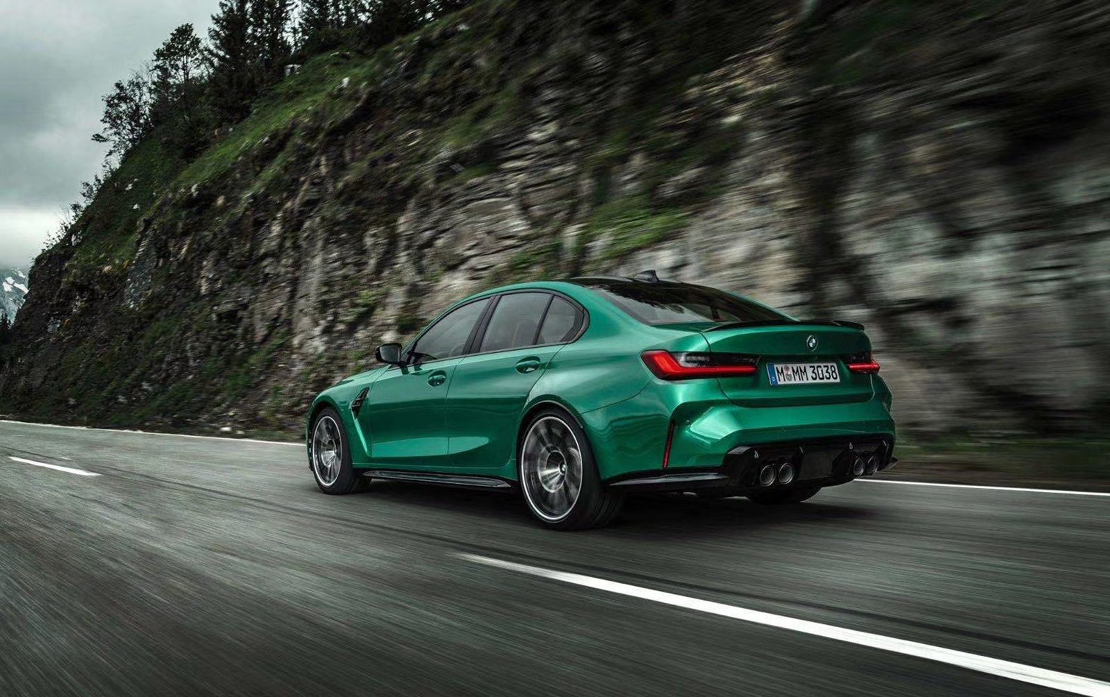 2021 BMW M3 and M4 Leak M3 driving rear three quarter