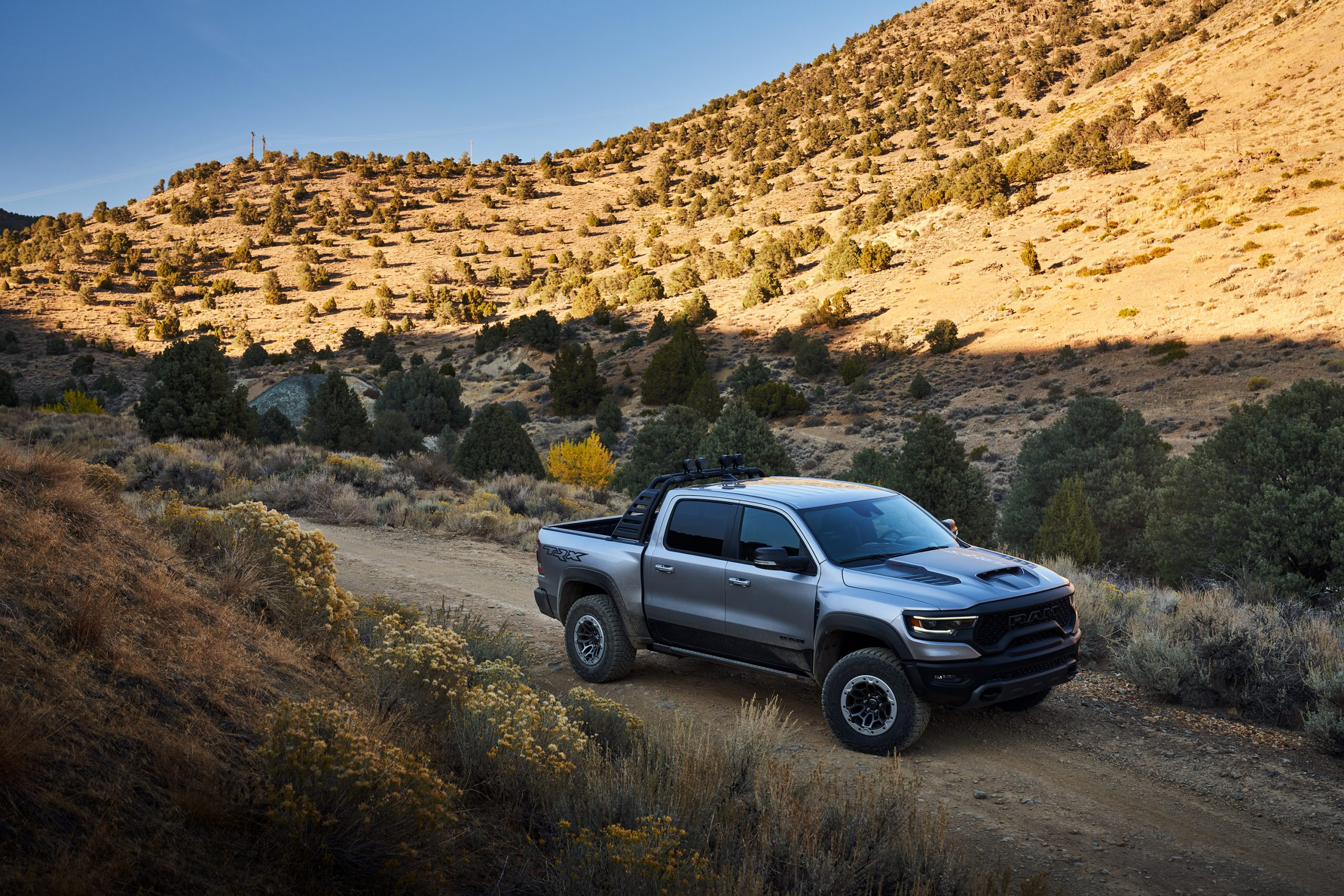 2021 Ram 1500 TRX front three-quarter on mountain pass trail