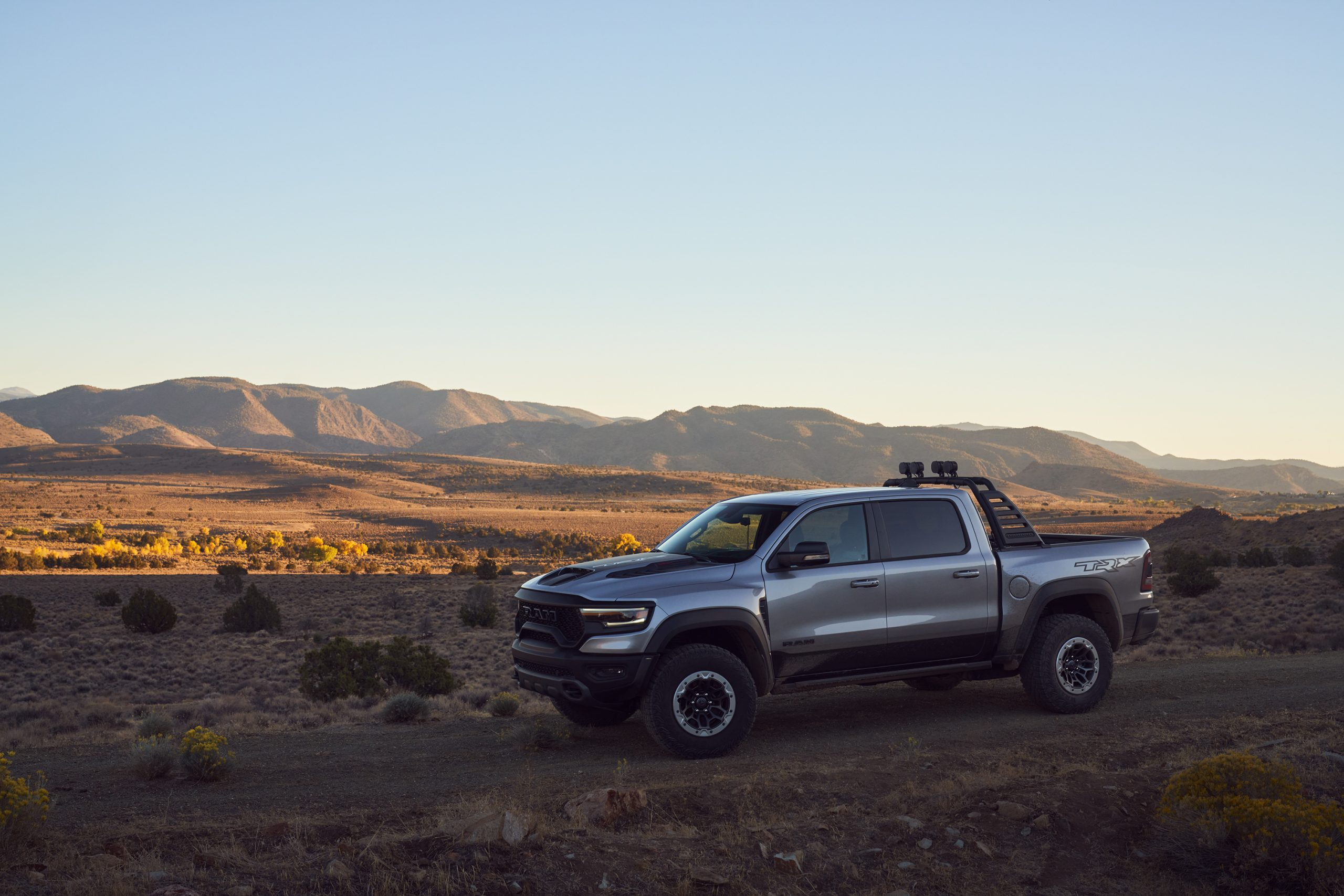 2021 Ram 1500 TRX front three-quarter mountain range backdrop