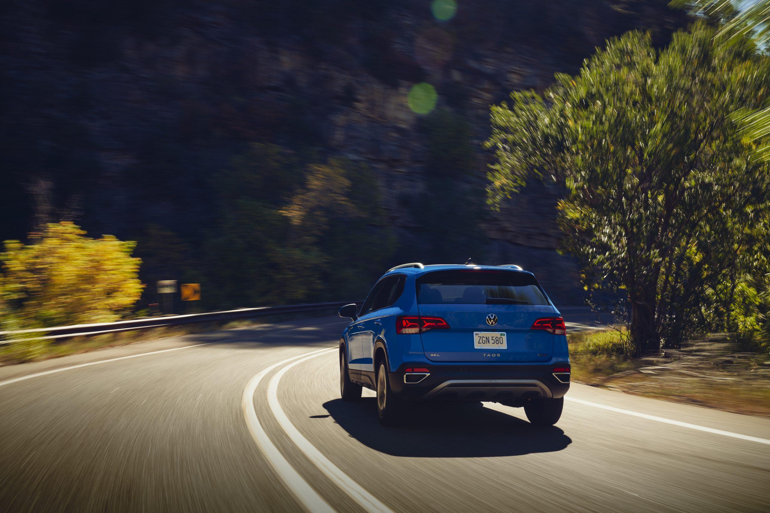 2022 Volkswagen Taos driving drivers rear three quarter