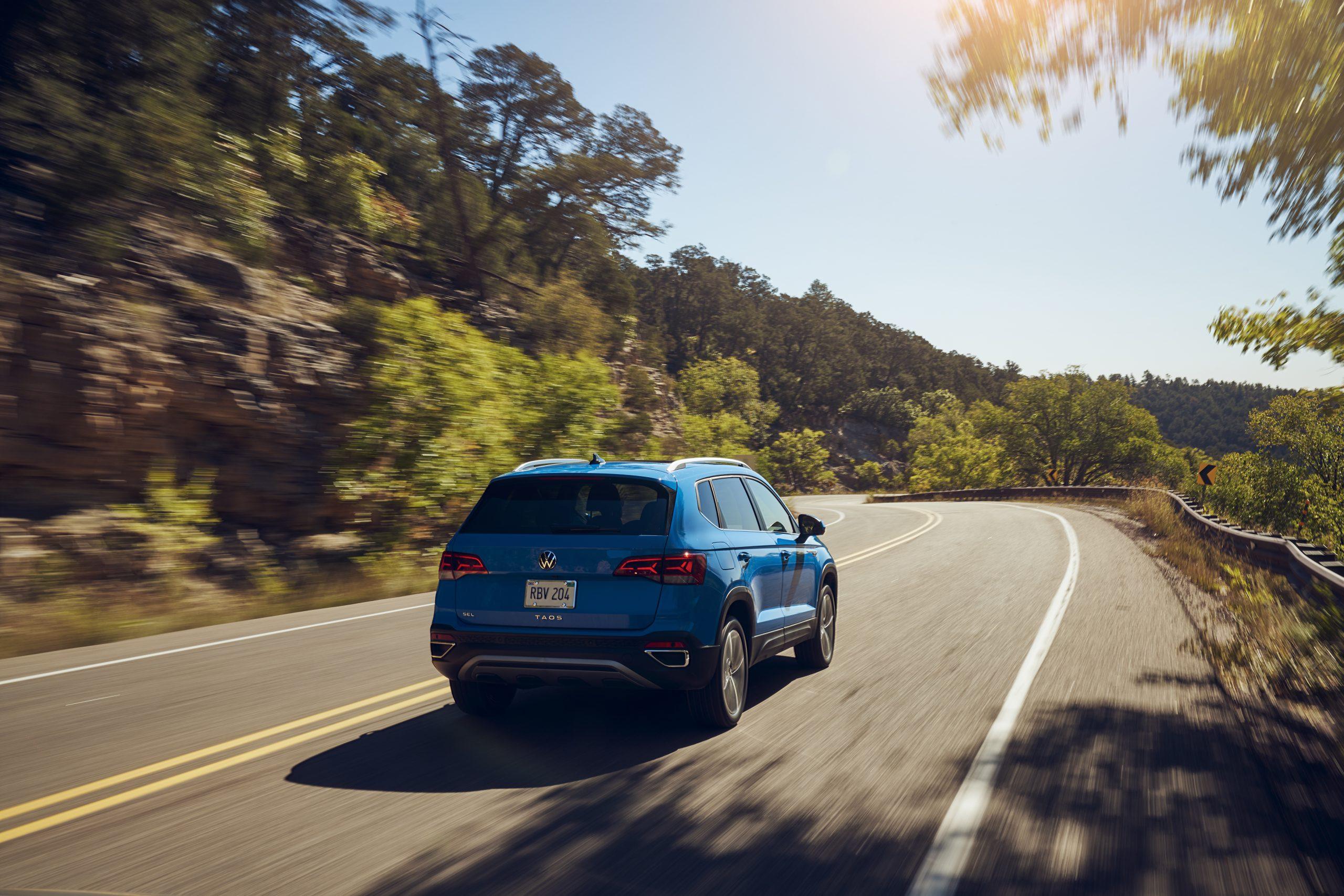 2022 Volkswagen Taos driving rear three quarter