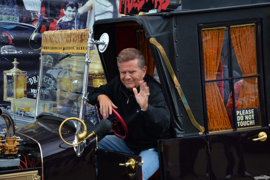 former child actor Butch Patrick at wheel of munster koach