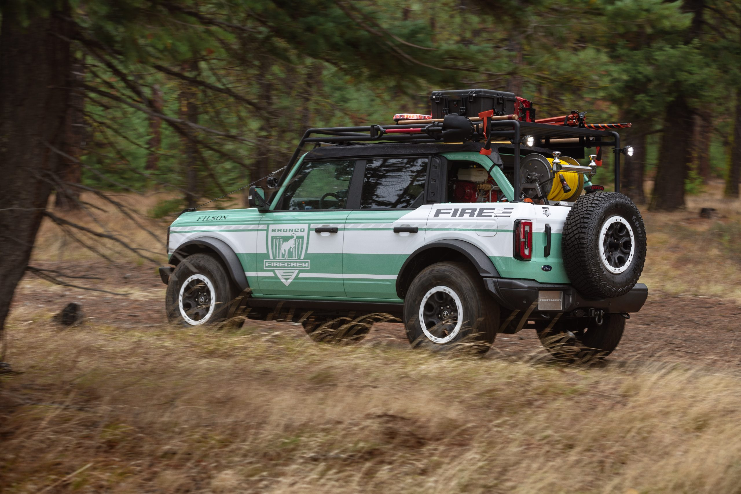 Bronco + Filson Wildland Fire Rig Concept driving in woods