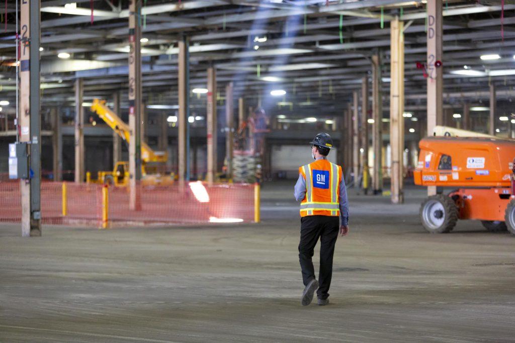 factory zero plant worker walks interior