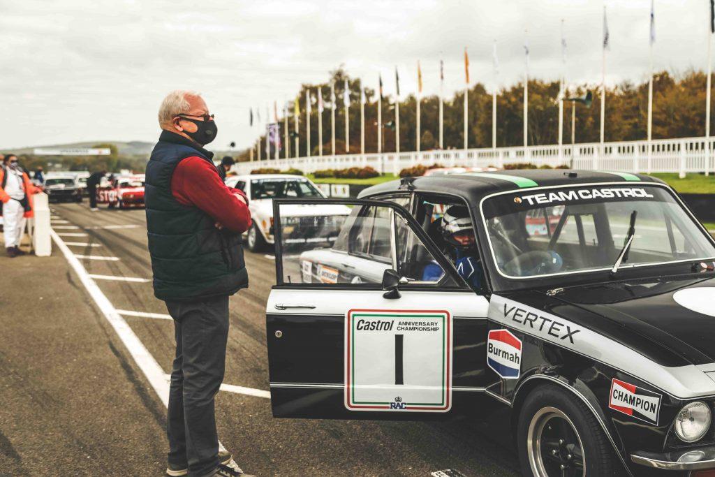 Philip Venables standing beside vintage bmw racecar