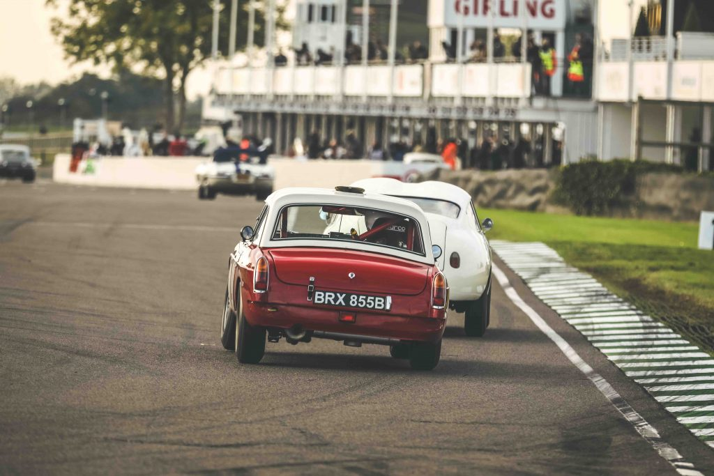goodwood speedweek two tone red white coupe rear racing action