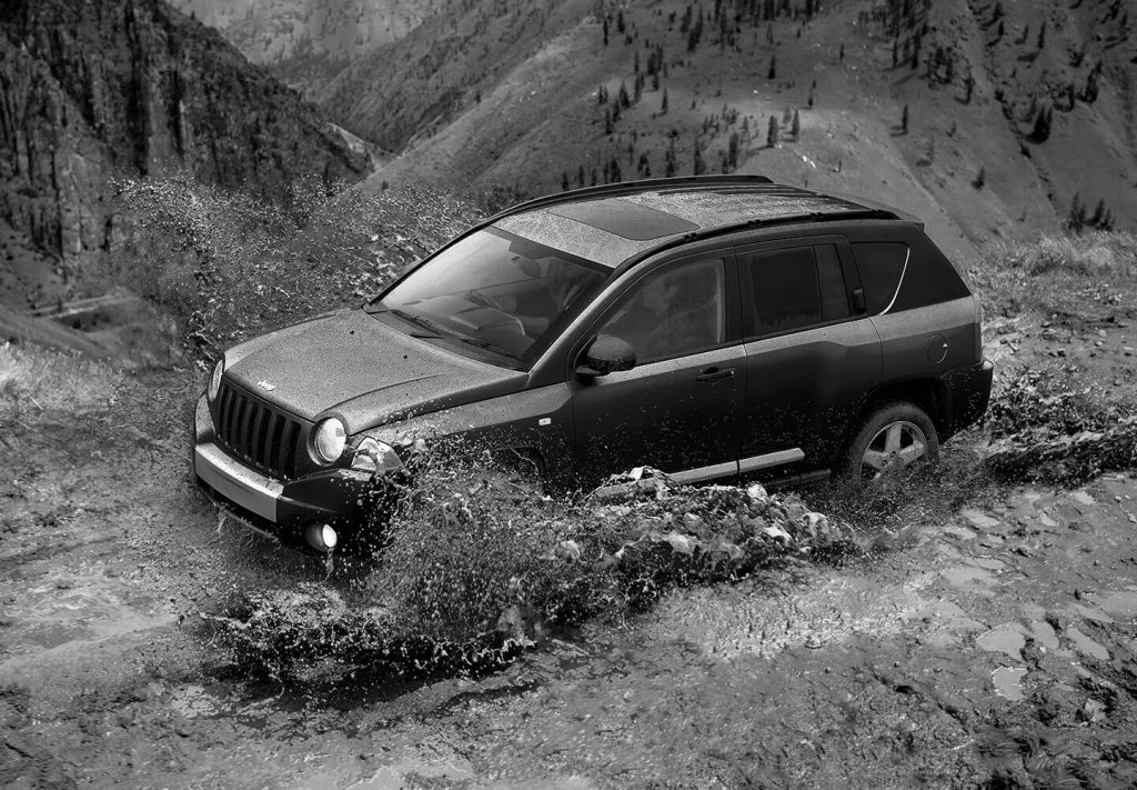 first gen jeep compass off roading mud action