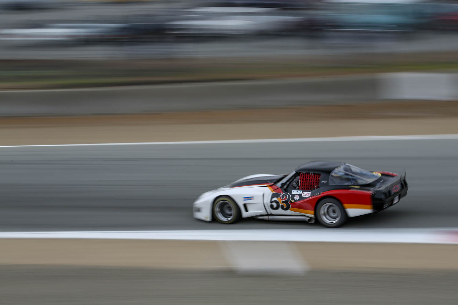 Laguna seca race car rear three-quarter action