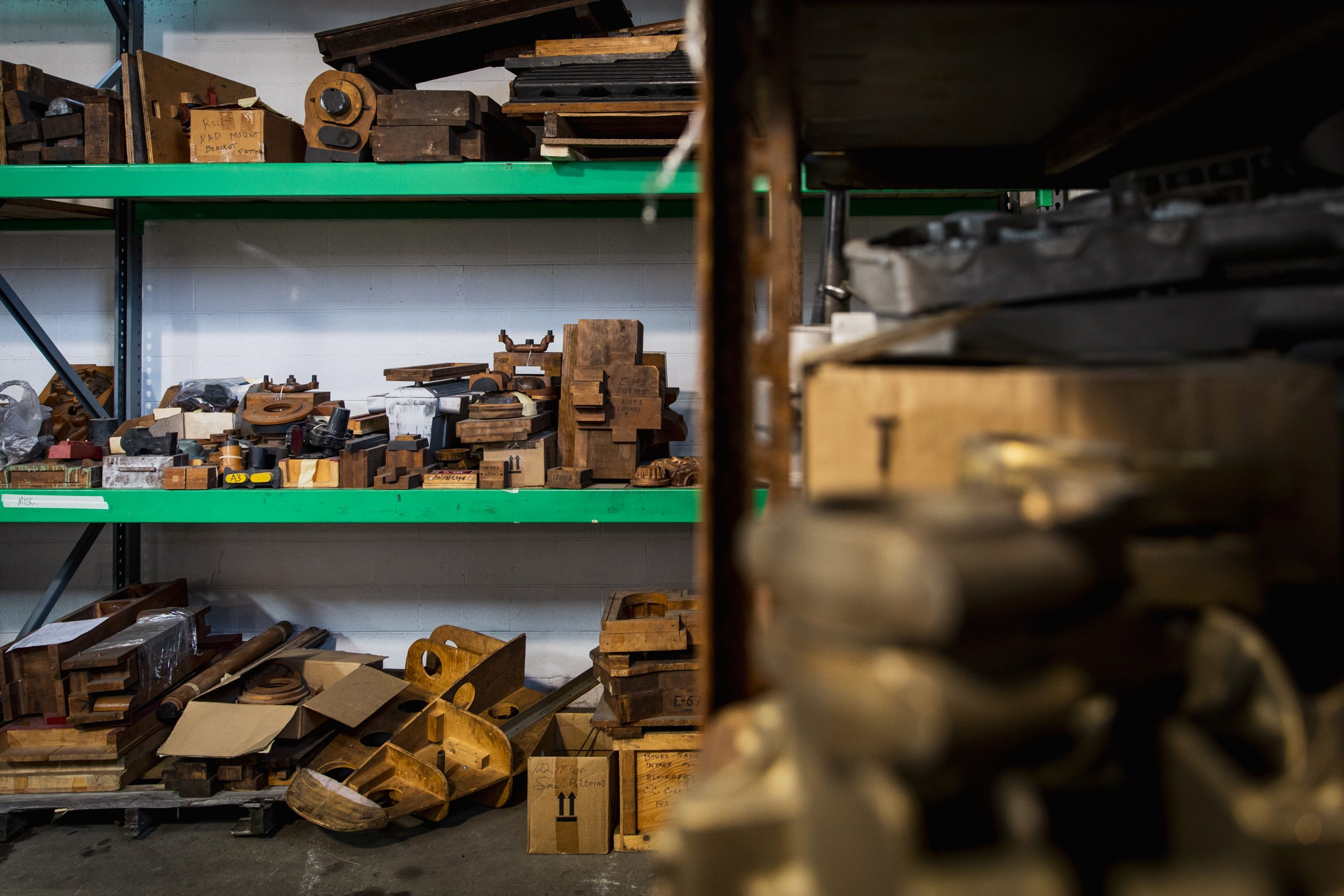 vintage racing parts on shelves