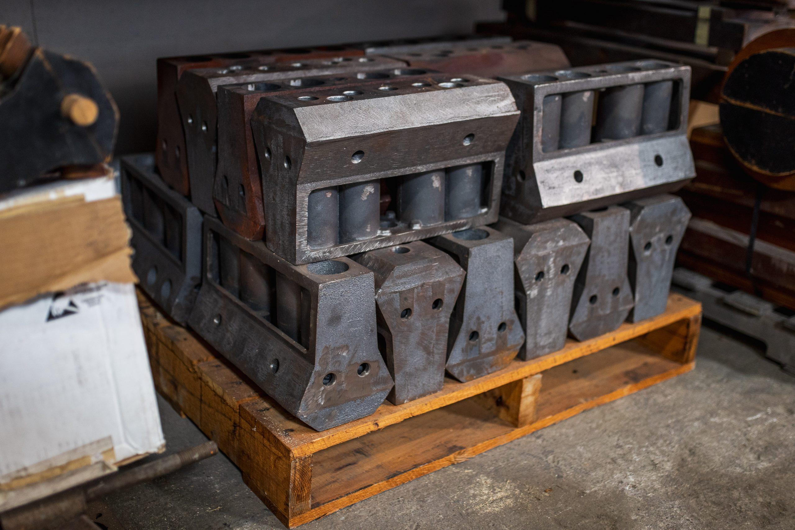vintage engine blocks on pallet