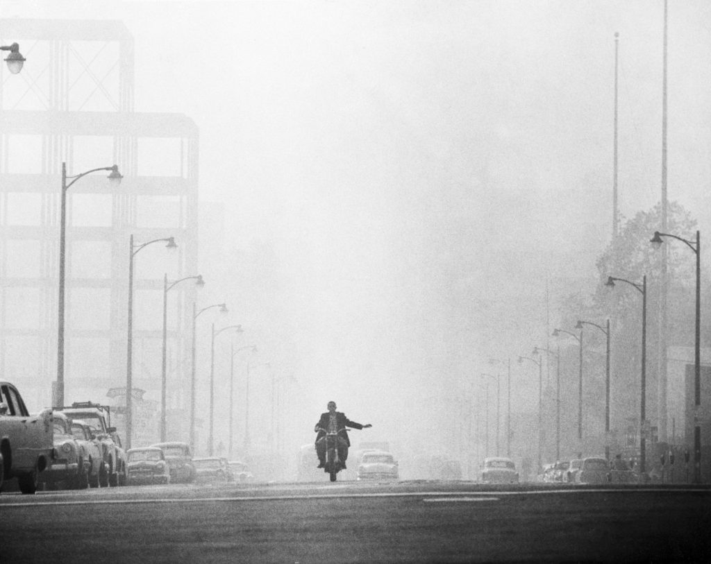 Motorcyclist Surrounded by Smog