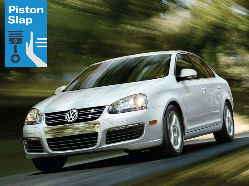 white VW Jetta dynamic action front three-quarter