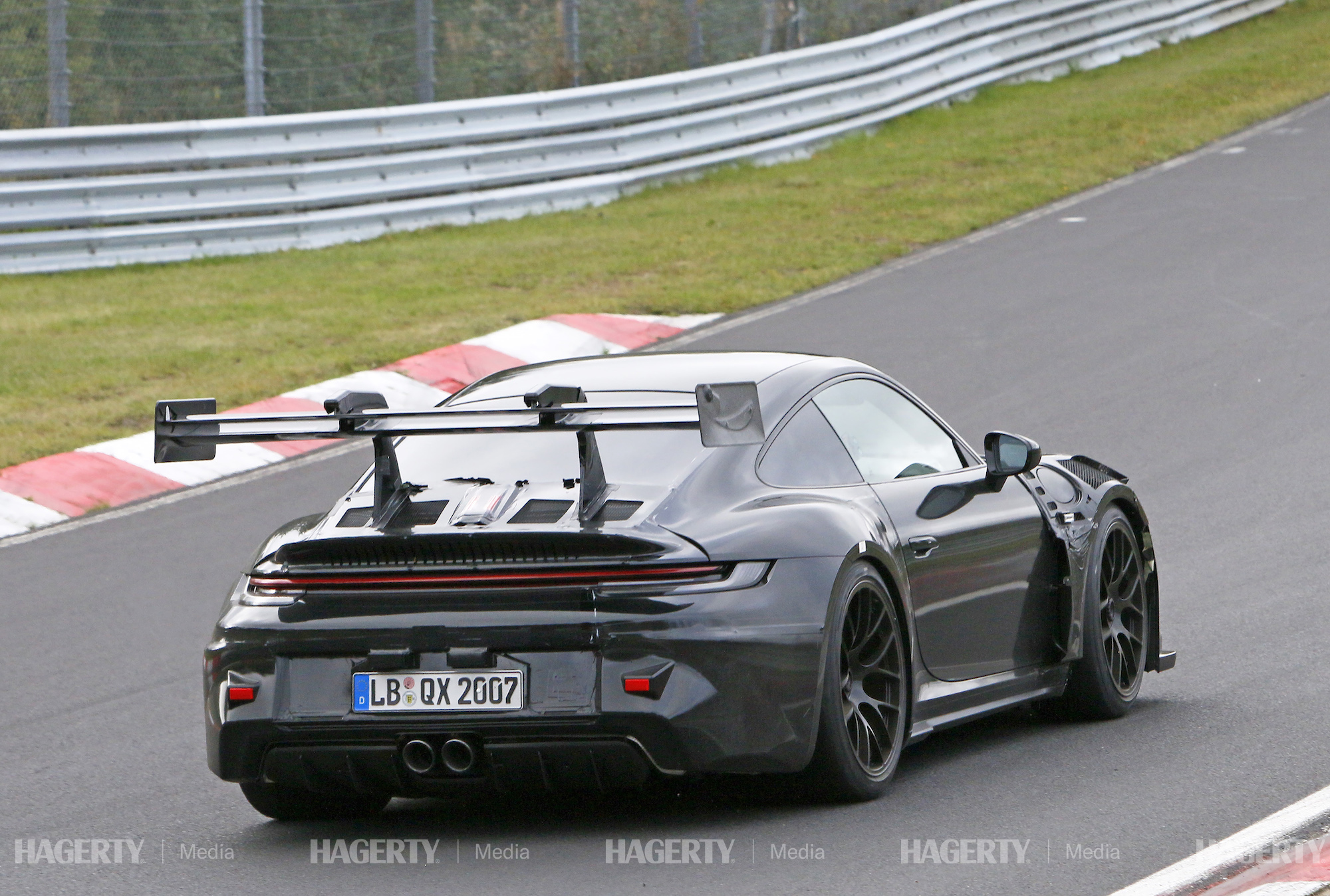 new porsche gt3 rs prototype rear three-quarter track action