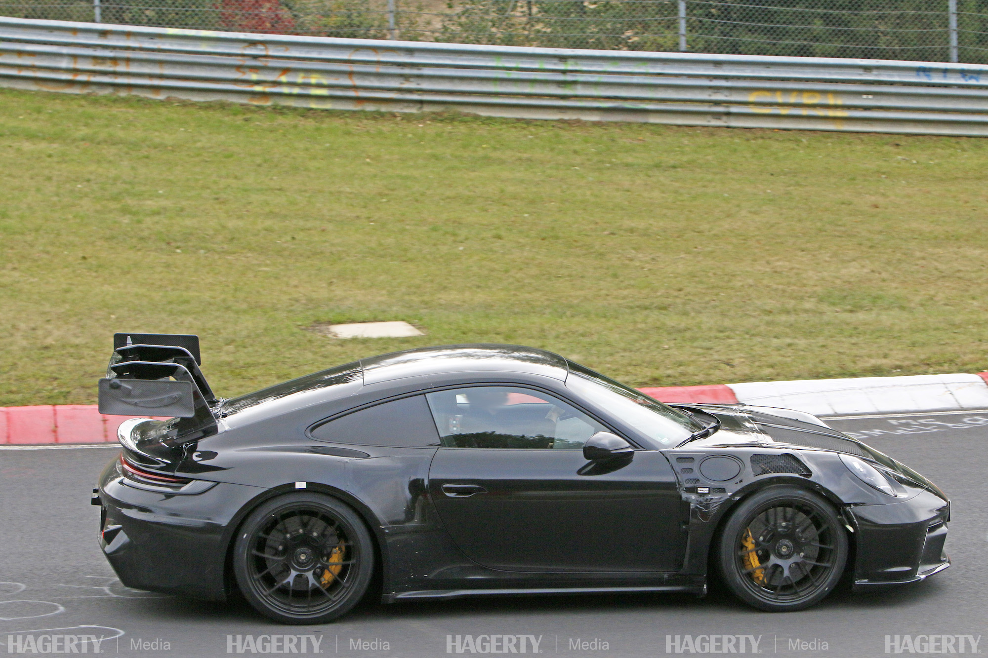 new porsche gt3 rs prototype side profile track action