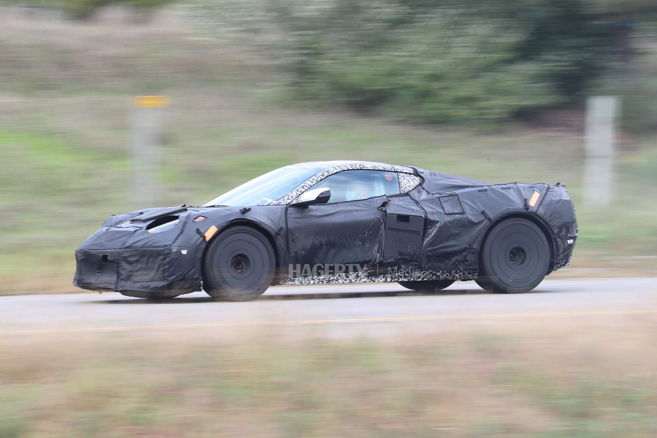 chevrolet c8 corvette z06 front three-quarter camo spy shot