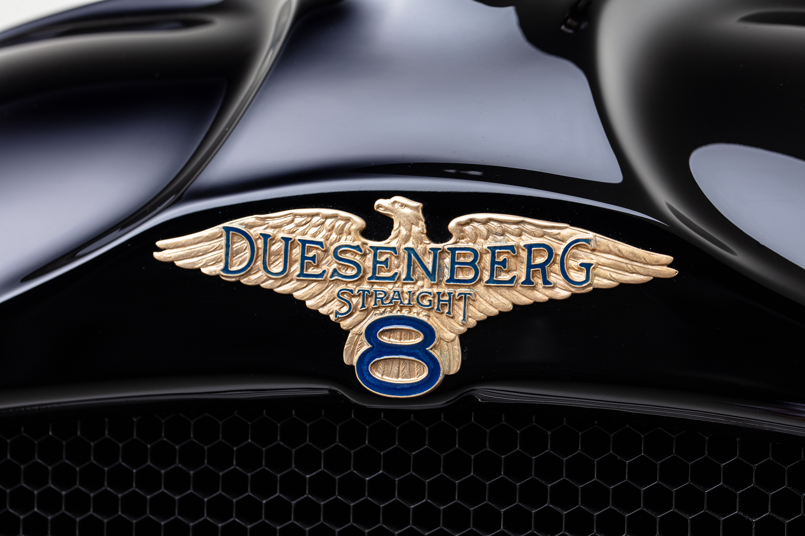 Duesenberg straight eight logo icon ornament close