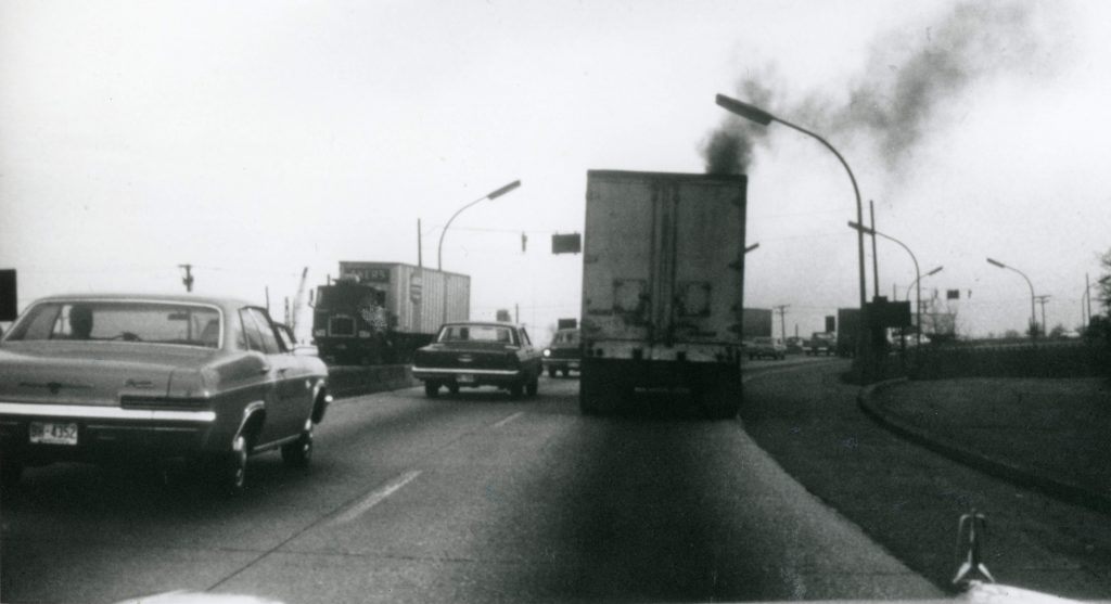semi truck releasing emissions into air