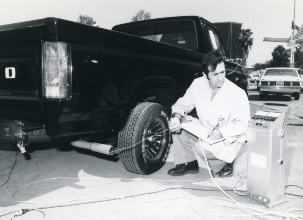 CARB staff checks tailpipe emissions of a Ford truck.