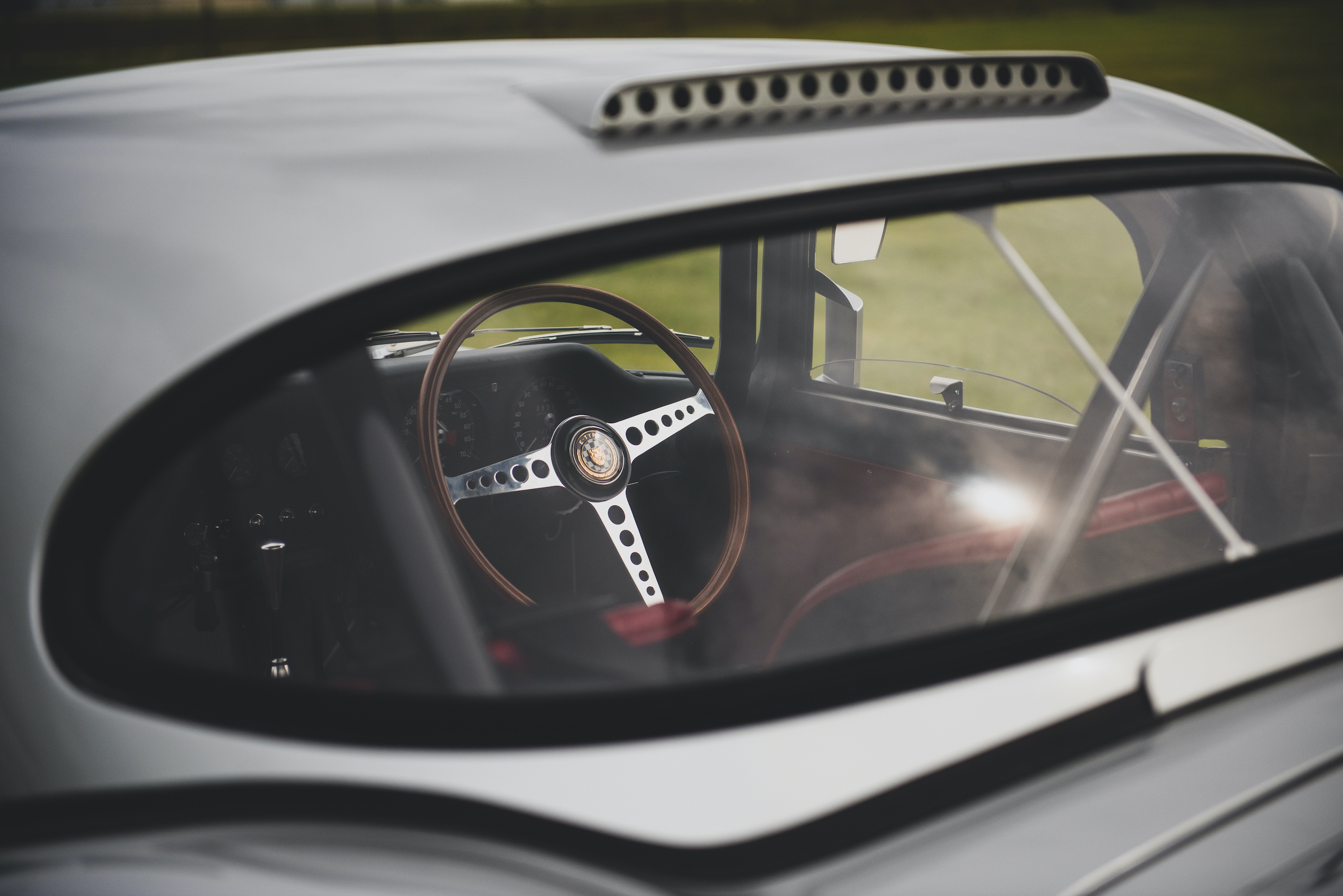 1963 Jag E Type steering wheel through rear glass