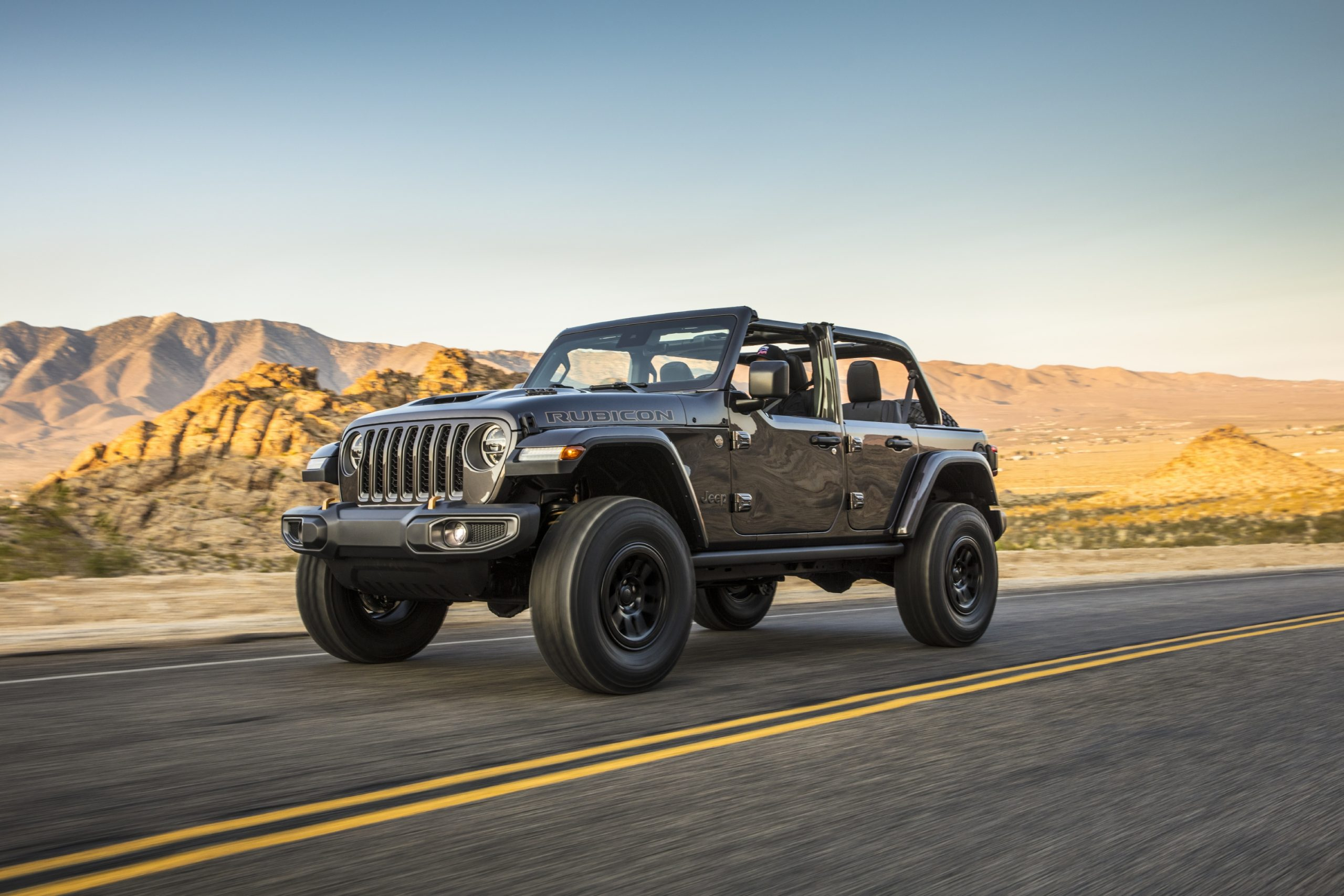 2021 Jeep Wrangler Rubicon 392 gray on road front three quarter moving