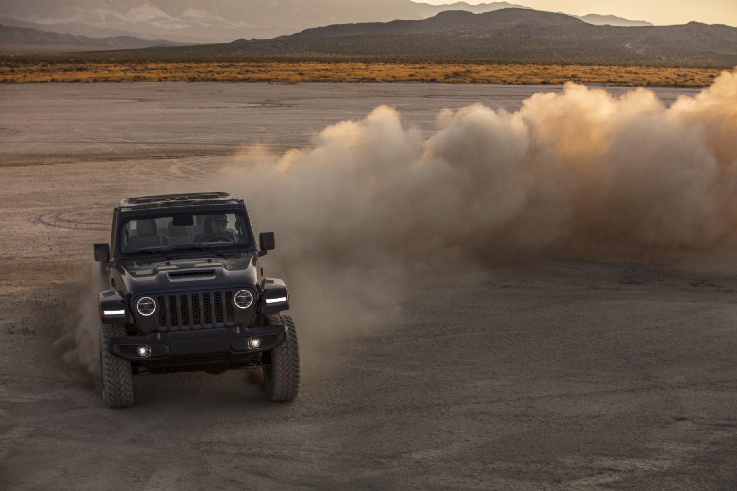2021 Jeep Wrangler Rubicon 392 gray making dust clouds